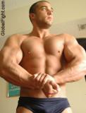 young muscle dude flexing.jpg