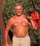 man chain sawing trees.jpg