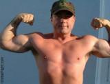 biceps army daddy flexing.jpeg