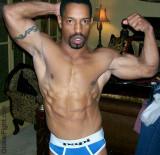 biceps flexed hot man.jpg