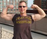 biceps flexing jock wrestler.jpg