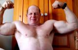 biceps older bear flexing.jpg