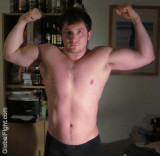 biceps younger jock flexing.jpg
