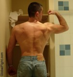 dormjock muscular back flexing.jpeg