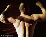 delts biceps flexing gym.jpg