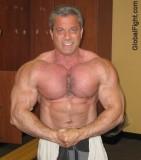 musclebear posing shirtless man.jpeg