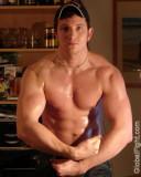 sweaty guy flexing shirtless.jpg