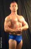 sweaty muscle guy flexing.jpg