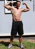 sweaty younger dude flexing.jpeg