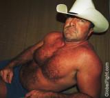 cowboy undressing shorts rancher.jpg