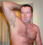 big arms hairy biceps man flexing.jpg