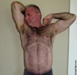 gray silver daddie fox bear cub flexing hairy armpits.jpg