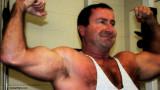 huge bearish daddy man double biceps pose flexing.jpg
