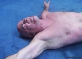 older wrestler in painful wrestling holds grips vice.jpg