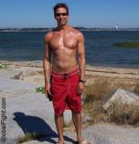 beach lean tanned guy.jpeg