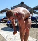 beach man tanning lotion.jpeg