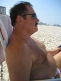 beach moustache stocky man.jpeg