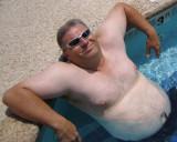 big husky macho man beefy bear swimming poolside.jpg