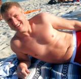 blond hunky hunks on beach blue eyed eyes men.jpg