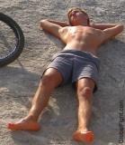 boy sandy beach suntanning.jpg