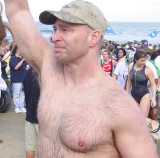 extremely hairy man jogging running event beach.jpg