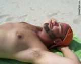 hairy daddy man suntanning on beach guys.jpg