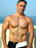 handsome tanned muscle beach man.jpeg