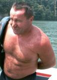man removing life jacket swimming bear.jpg