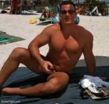man sitting on beach suntanning bathing.jpg
