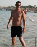 man swimming beach ocean guys tanning.jpg