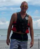 man wearing boating life jacket wearing vest swimming.jpg