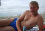 men drunk drinking beer on beach blond studly hunks.jpg