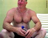 muscle dad hunk poolside sunbathing daddy.jpg