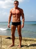 musclejock ocean swimming island man tanned.jpg
