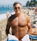 older silverdaddie man beach swimming.jpg