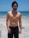 son at beach brother on sandy ocean front.jpg