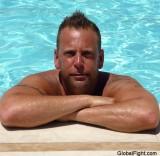 tanned man swimming pool sunbathing gay men.jpg