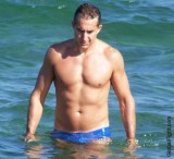 tanned smooth muscle guy swimming dude.jpg