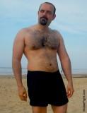 very hairy chest man on beach sandy.jpg