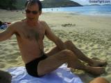 wet guy suntanning on beach soaked man swimming.jpg
