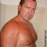 wet handsome bathing man.jpg