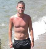 wet man swimming beach pool men shorts.jpg
