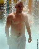 wet man swimming water park showering guy.jpg