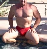wet poolside muscleman swimming.jpeg
