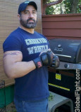 caps biceps daddy flexing.jpg