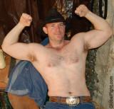 cowboy flexing big biceps.jpg