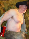 cowboy rancher removing shirtless working barn.jpg