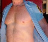 fireman taking off shirt husky hunk.jpg