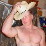 hairy man removing cowboy hat.jpg