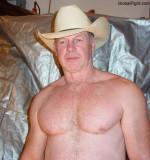 hot muscular older cowboy daddy.jpg